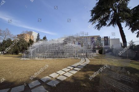 Visitors look at the 541 square meters structure 'The Cloud' by Japanese artist Sou Fujimoto displayed in Tirana, Albania, 23 January 2017. The artwork has two entrances and was created for visitors to interact with the walls, seating and roof of the structure that is made of steel.
