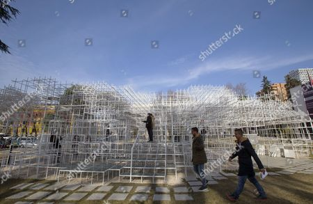 Stock Photo of Visitors look at the 541 square meters structure 'The Cloud' by Japanese artist Sou Fujimoto displayed in Tirana, Albania, 23 January 2017. The artwork has two entrances and was created for visitors to interact with the walls, seating and roof of the structure that is made of steel.