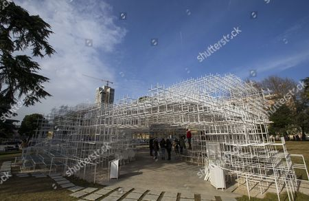 Stock Image of Visitors look at the 541 square meters structure 'The Cloud' by Japanese artist Sou Fujimoto displayed in Tirana, Albania, 23 January 2017. The artwork has two entrances and was created for visitors to interact with the walls, seating and roof of the structure that is made of steel.