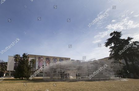 Stock Picture of Visitors look at the 541 square meters structure called 'The Cloud' made by Japanese artist Sou Fujimoto in the centre of Tirana, Albania, 23 January 2017. The steel artwork has two entrances and was created for the visitors to interact with the walls, seating and roof of the structure.