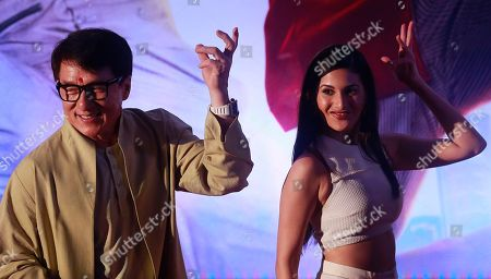 """Stock Picture of Jackie Chan, Amyra Dastur Hong Kong actor Jackie Chan, left, performs with Indian actress Amyra Dastur during an event to promote his new movie """"Kung Fu Yoga"""" in Mumbai, India"""