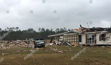 The aftermath of a possible tornado in Cook County, Ga., is seen. Residents in Georgia, Mississippi and South Carolina are trying to pick up the pieces left behind by a powerful storm system that tore across the Deep South over the weekend, killing 19 people, including 15 in south Georgia