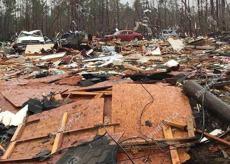 Mobile homes and vehicles lay destroyed by a possible tornado in Cook County, Ga. Residents in Georgia, Mississippi and South Carolina are trying to pick up the pieces left behind by a powerful storm system that tore across the Deep South over the weekend, killing 19 people, including 15 in south Georgia