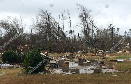 Stock Picture of Mobile homes and vehicles lay destroyed by a possible tornado in Cook County, Ga. Residents in Georgia, Mississippi and South Carolina are trying to pick up the pieces left behind by a powerful storm system that tore across the Deep South over the weekend, killing 19 people, including 15 in south Georgia