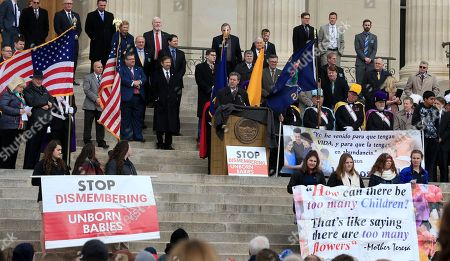 Kansas Gov. Sam Brownback speaks to Roe v. Wade protesters from the steps of the Statehouse in Topeka, Kan., as hundreds converged on the Kansas Statehouse to mark the 1973 Supreme Court decision that legalized abortion nationwide, . Abortion opponents expressed optimism Monday that Donald Trump's early months in office would advance their cause
