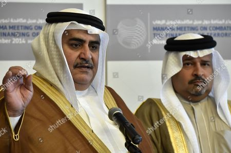 Bahrain Foreign Minister Sheikh Khalid Bin Ahmed Al-khalifa (l) and Bahrains Minister of Finance Sheikh Ahmed Bin Mohammed Al-khalifa (r) Speak to Media During the One-day 'Manama Meeting on Combating Funding Terrorism'¥ in the Bahraini Capital Manama 09 November 2014 an International Seminar on Combating Terrorism Funding Opened in Bahrain on 9 November 2014 Which Has Security and Finical Experts From More Than 30 Countries As Well As the Un World Bank International Monetary Fund (imf) European Union (eu) Arab League and Gulf Cooperation Council (gcc) at a Time when the Gulf States Are Facing Increasing Threat From Islamic State of Iraq and Syria (isis) and Al-qaeda Bahrain Manama