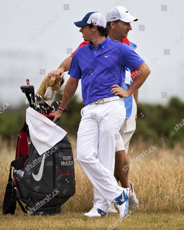 Northern Ireland's Golfer Rory Mcilroy (l) and His Caddie Jp Fitzgerald (r) Look Around on the Fairway of the 14th During the Third Practice Day Prior the British Open Golf Championship at Muirfield Golf Course in Gullane Scotland Britain 17 July 2013 the Open Championship One of Golf's Major Events Begins on 18 July with the Final Round Taking Place on 21 July 2013 United Kingdom Gullane