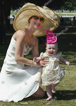 Isabella Blake's Nine-month old daughter Isabella Blake-Thomas is the height of fashion in a pink bonnet on the fourth day of Royal Ascot race meeting