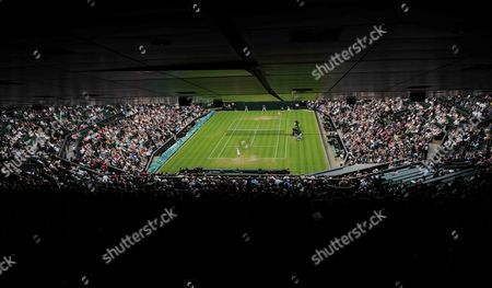 A General View of Centre Court As Agnieszka Radwanska of Poland Serves to Mathilde Johansson of France During Their Second Round Match For the Wimbledon Championships at the All England Lawn Tennis Club in London Britain 27 June 2013 United Kingdom Wimbledon