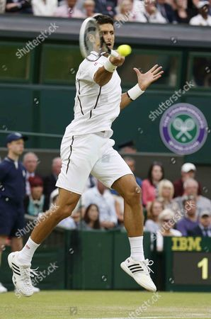 Novak Djokovic of Serbia Returns to Bobby Reynolds of Usa During Their Second Round Match For the Wimbledon Championships at the All England Lawn Tennis Club in London Britain 27 June 2013 United Kingdom Wimbledon