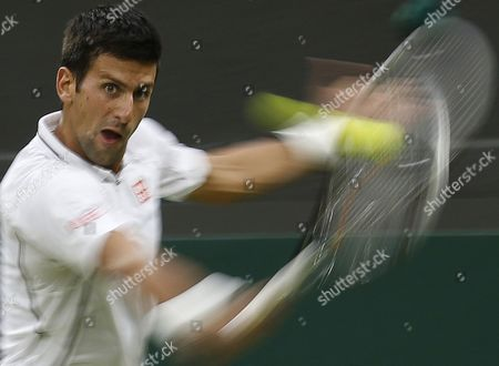 A Slow Exposure Picture Shows Novak Djokovic of Serbia Returning to Bobby Reynolds of Usa During Their Second Round Match For the Wimbledon Championships at the All England Lawn Tennis Club in London Britain 27 June 2013 United Kingdom Wimbledon