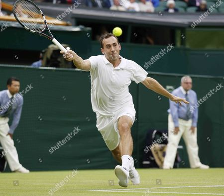 Bobby Reynolds of Usa Returns to Novak Djokovic of Serbia During Their Second Round Match For the Wimbledon Championships at the All England Lawn Tennis Club in London Britain 27 June 2013 United Kingdom Wimbledon