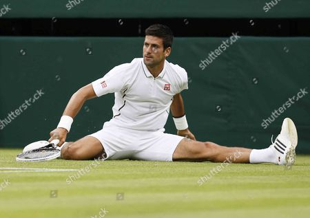 Novak Djokovic of Serbia Falls After Returning to Bobby Reynolds of Usa During Their Second Round Match For the Wimbledon Championships at the All England Lawn Tennis Club in London Britain 27 June 2013 United Kingdom Wimbledon