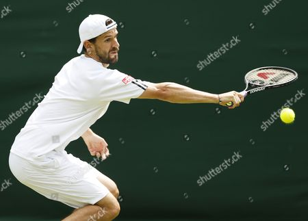 Philipp Petzschner of Germany Returns to Michal Przysiezny of Poland During Their First Round Match For the Wimbledon Championships at the All England Lawn Tennis Club in London Britain 25 June 2013 United Kingdom Wimbledon