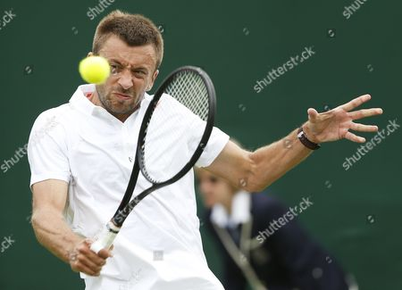Michal Przysiezny of Poland Returns to Philipp Petzschner of Germany During Their First Round Match For the Wimbledon Championships at the All England Lawn Tennis Club in London Britain 25 June 2013 United Kingdom Wimbledon