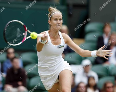Mathilde Johansson of France Returns to Agnieszka Radwanska of Poland During Their Second Round Match For the Wimbledon Championships at the All England Lawn Tennis Club in London Britain 27 June 2013 United Kingdom Wimbledon