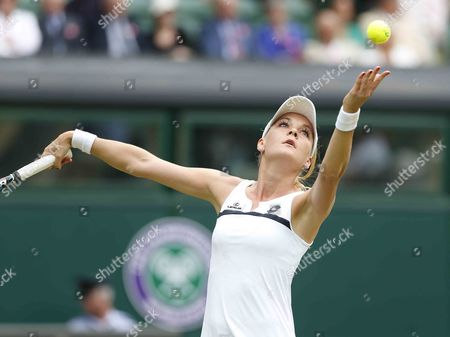 Agnieszka Radwanska of Poland Serves to Mathilde Johansson of France During Their Second Round Match For the Wimbledon Championships at the All England Lawn Tennis Club in London Britain 27 June 2013 United Kingdom Wimbledon