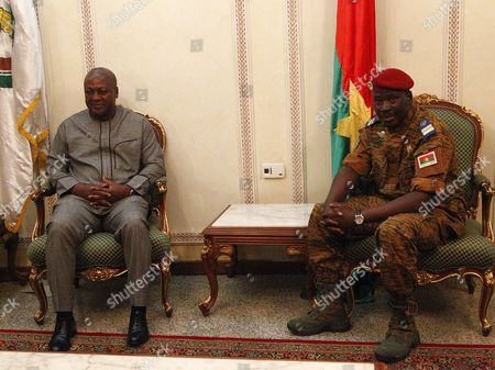 Transitional Leader of Burkina Faso Lieutenat-colonel Isaac Zida (r) Meets with President of Ghana John Mahama Dramani (l) at the Airport Prior to a Meeting of Ecowas Leaders in Ouagadougou Burkina Faso 05 November 2014 the Presidents of Ghana Nigeria and Senegal Visited Ouagadougou to Meet with the Military to Negotiate For the Return to Civilian Rule President Blaise Compaore on 31 October 2014 Resigned Following the Violent Protests Against His Bid to Change the Constitution to Extend His Rule of 27 Years Presidential Guard Commander Lieutenat-colonel Isaac Zida Assumed the Role of Transitional Leader But the African Union (au) Has Issued the Military a Two-week Time Frame to Hand Power to a Civilian Ruler Or Face Sanctions Burkina Faso Ouagadougou