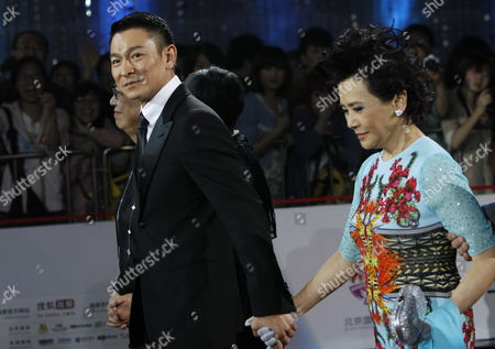 Hong Kong Actor Andy Lau (c) Actress Deanie Ip (r) and Director Ann Hui (back) Arrive For the Opening of the Beijing International Film Festival in Beijing China 23 April 2012 the Beijing International Film Festival Will Run From 23 to 28 April China Beijing