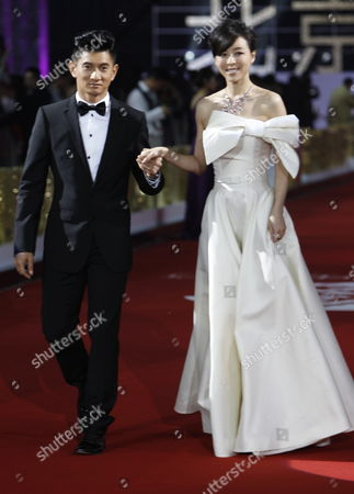 Stock Photo of Taiwanese Actor Nicky Wu (l) and Chinese Actress Zhang Jingchu Arrive For the Opening of the Beijing International Film Festival in Beijing China 23 April 2012 the Beijing International Film Festival Will Run From 23 to 28 April China Beijing