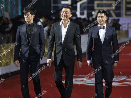 Stock Picture of Hong Kong Actors Tony Leung Kar Fai (c) Aaron (r) and Aarif Lee Pose For Photos As They Arrive For the Opening of the Beijing International Film Festival in Beijing China 23 April 2012 the Beijing International Film Festival Will Run From 23 to 28 April China Beijing