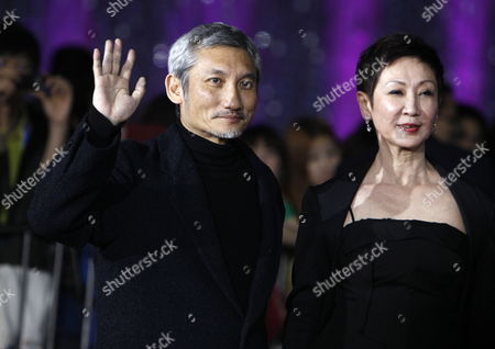 Hong Kong Film Director Tsui Hark (l) and His Wife Shi Nansun Arrive For the Opening of the Beijing International Film Festival in Beijing China 23 April 2012 the Beijing International Film Festival Will Run From 23 to 28 April China Beijing
