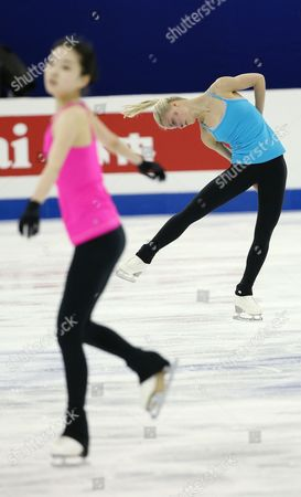 Kiira Korpi of Finland (r) and Li Zijun of China Perform During a Practice Session For the Women's Singles of the Isu World Figure Skating Championships at the Shanghai Oriental Sports Center Stadium in Shanghai China 23 March 2015 the 2015 World Figure Skating Championships in Shanghai Will Start on 25 March Until 29 March 2015 China Shanghai