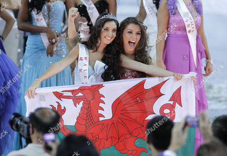 First Runner-up Sophie Elizabeth Mould (c-l) of Wales Holds a Welsch Flag While Being Cheered by 'Miss England' Charlotte Holmes (r) After the Finals of the 'Miss World' Pageant in the Dongsheng Stadium in Ordos Inner Mongolia China 18 August 2012 'Miss China' Became the Newly Crowned 'Miss World' of the 62nd Edition of the Pageant Held in Ordos China Ordos