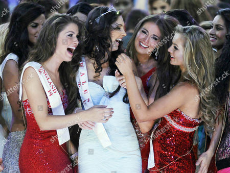 First Runner-up Sophie Elizabeth Mould (c in White) of Wales is Congratulated by Other Contestants After the Finals of the 'Miss World' Pageant in the Dongsheng Stadium in Ordos Inner Mongolia China 18 August 2012 on Left is 'Miss England' Charlotte Holmes 'Miss China' Became the Newly Crowned 'Miss World' of the 62nd Edition of the Pageant Held in Ordos China Ordos