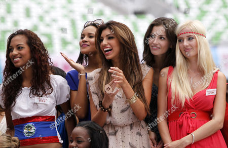 (l-r) Miss Belize Chantae Guy Miss Tanzania Lisa Peter Jensen Miss Aruba Lucianette Verhoeks Miss Belarus Yuliya Skalkovic and Miss Kazakhstan Evgeniya Klishina Share a Light Moment During a Rehearsal of the Opening Ceremony of the Miss World Pageant in Dongsheng Stadium in Ordos Inner Mongolia China 23 July 2012 the Miss World 2012 Beauty Pageant Will Be Held in China where It Will Stage the Opening Ceremony and Finals in Ordos on 24 July and 18 August Respectively China Beijing