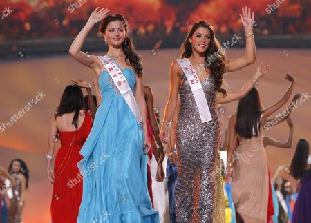 Miss Belarus Yuliya Skalkovich (front L) and Miss England Charlotte Holmes (front R) Wave During the Opening Ceremony of the Miss World Pageant in Dongsheng Stadium in Ordos Inner Mongolia China 24 July 2012 the 62nd Edition of the Miss World Pageant Will Be Held in Ordos on 18 August China Ordos