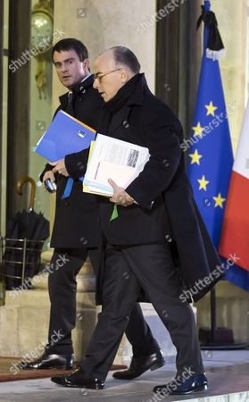 French Prime Minister Manuel Valls (l) and Interior Minister Bernard Cazeneuve (r) Arrive For a Crisis Cabinet Meeting at the Elysee Palace in Paris France 08 January 2015 Government Ministers Met Early in the Morning the Day After an Attack when Gunmen Opened Fire at the 'Charly Hebdo' Satirical Newspaper Headquarters in Paris Killing 12 People France Paris