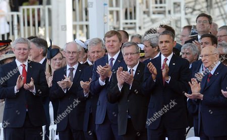(l-r) Canadian Prime Minister Stephen Harper European Council President Herman Van Rompuy Belgian King Philippe Netherlands King Willem-alexander Polish President Bronislaw Komorowski Us President Barack Obama President of Italy Giorgio Napolitano Slovakian President Ivan Gasparovic at Sword Beach During a Service of Remembrance in Ouistreham Normandy France 06 June 2014 World Leaders Are Gathering in Normandy 06 June to Commemorate the 70th Anniversary of the D-day Landings France Ouistreham