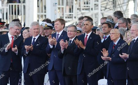(l-r) Canadian Prime Minister Stephen Harper Belgian King Philippe Netherlands King Willem-alexander Polish President Bronislaw Komorowski Us President Barack Obama President of Italy Giorgio Napolitano Slovakian President Ivan Gasparovic at Sword Beach During a Service of Remembrance in Ouistreham Normandy France 06 June 2014 World Leaders Are Gathering in Normandy 06 June to Commemorate the 70th Anniversary of the D-day Landings France Ouistreham
