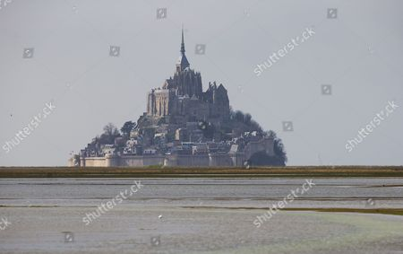 High Tidal Waters Flood Land Usually Used As Grazing Fields For Local Herds of Sheep Across From Mont Saint-michel in France 21 March 2015 This Year a Rare Confluence of Astronomical Factors is Prompting what Some in France Have Called the 'Tide of the Century ' and Driving Tourists to the Bay of Mont-saint-michel at Even High Numbers Than Usual Water Levels Are Expected to Reach 13 45 Metres High Higher Than a Four-story Building at Approximately 7:45 a M and 8 P M on 21 March and 8:30 a M and 8:50 P M on 22 March 2015 Due to Its Location Mont-saint-michel is One of the Places Most Vividly Affected by the Tides in All of Europe the Ocean Will Completely Cover a Low Bridge That Connects the Promontory to the Mainland 2 Kilometres Away France Mont Saint Michel
