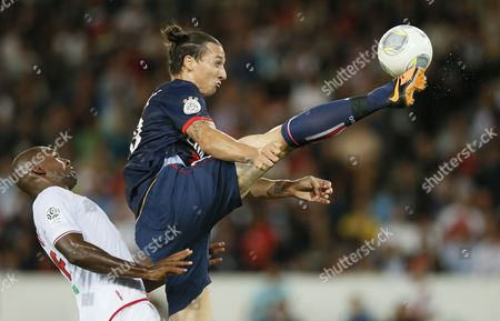 Zlatan Ibrahimovic of Paris Saint Germain (r) and Ronald Zubar of Ac Ajaccio (l) Vie For the Ball During Their League 1 Soccer Match Between Psg and Ac Ajaccio at the Parc Des Princes Stadium in Paris France 18 August 2013 France Paris