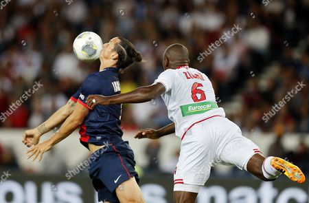 Zlatan Ibrahimovic of Paris Saint Germain (l) and Ronald Zubar of Ac Ajaccio (r) Vie For the Ball During the League One Soccer Match Between Psg and Ac Ajaccio at the Parc Des Princes Stadium in Paris France 18 August 2013 France Paris