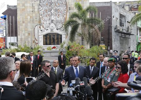 Australian Prime Minister Tony Abbott Speaks to the Media Next to Bombing Victim Australian Peter Hughes (to Abbott's L) in Front of the Bali Bombing Memorial After Laying a Wreath at the Memorial to Those Killed in the 2002 Bali Bombing in Kuta Bali Indonesia 09 October 2013 There Were 202 People Killed in the Bombings Including 88 Australians Indonesia Kuta