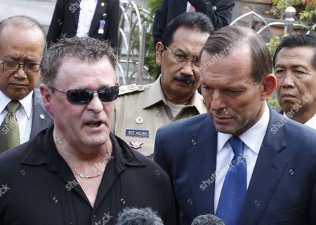 Stock Photo of Australian Prime Minister Tony Abbott (r) Listens to Bali Bombing Survivor Australian Peter Hughes (l) As They Speak to the Media After Abbott Laid a Wreath at the Memorial to Those Killed in the 2002 Bali Bombing in Kuta Bali Indonesia 09 October 2013 the Attacks 11th Anniversary is 12 October and Abbott Confirmed at the Site Victims of Terror in the Bali Bombings Would Be Part of a Compensation Scheme Indonesia Kuta