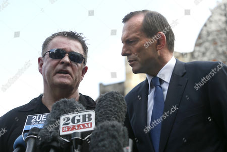 Australian Prime Minister Tony Abbott (r) Listens to Bali Bombing Survivor Australian Peter Hughes (l) As They Speak to the Media After Abbott Laid a Wreath at the Memorial to Those Killed in the 2002 Bali Bombing in Kuta Bali Indonesia 09 October 2013 the Attacks 11th Anniversary is 12 October and Abbott Confirmed at the Site Victims of Terror in the Bali Bombings Would Be Part of a Compensation Scheme Indonesia Kuta