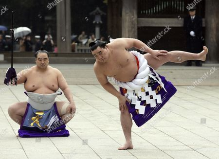 Yokozuna Or Grand Champion Sumo Wrestler Harumafuji Kohei (r) Mongolian-born As Davaanyamyn Byambadorj Performs a Ring Entrance Ceremony at the Start of the New Year at Meiji Shrine in Tokyo Japan 08 January 2014 the Ceremony is Held For a Prayer Oath to the Gods at the Start of the New Year Prior to the First Grand Sumo Tournament of the Year Japan Tokyo