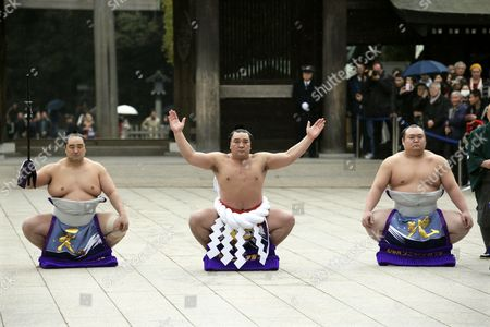 Yokozuna Or Grand Champion Sumo Wrestler Harumafuji Kohei (c) Mongolian-born As Davaanyamyn Byambadorj Performs a Ring Entrance Ceremony at the Start of the New Year at Meiji Shrine in Tokyo Japan 08 January 2014 the Ceremony is Held For a Prayer Oath to the Gods at the Start of the New Year Prior to the First Grand Sumo Tournament of the Year Japan Tokyo