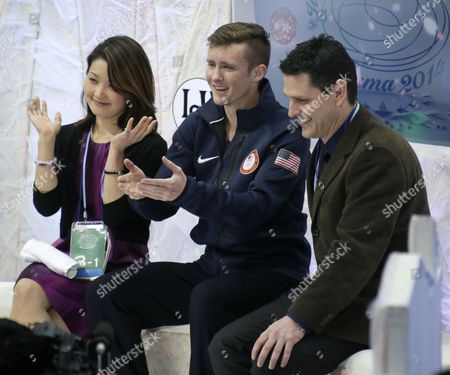 Jeremy Abbott (c) of the United States Rects with His Coaches Yuka Sato (l) and Jason Dungjen After Performing the Men's Singles Free Skating of the Isu World Figure Skating Championships in Saitama North of Tokyo Japan 28 March 2014 Abbott Placed Fifth Japan Saitama