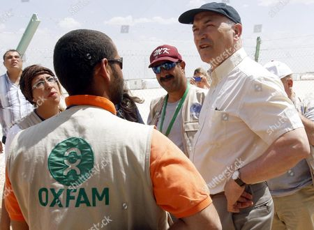 Chief of Oxfam Organization Mark Goldring (r) Talks with the Charity's Workers at Zatrai Syrian Refugee Camp Near the City of Mafraq Jordan 30 April 2013 the Jordanian Government on 21 April Called on the Un Security Council to Address the Syrian Refugee Crisis Driving Some 2 000 People Into Jordan Per Day Jordanian Officials at the Zatrai Camp Estimate the Number of Refugees at 180 000 Jordan Mafraq