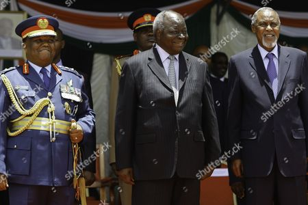Flanked by Chief of Defence Forces General Julius Waweru Karangi (l) and Defence Minister Mohamed Yusuf Haji (r Kenya's Outgoing President Mwai Kibaki Smiles Duirng a Farewell Ceremony Held at Moi Air Base in Nairobi Kenya 22 March 2013 Kibaki is to Hand Over the Power Upon the Swearing-in of the New President Kenya Nairobi