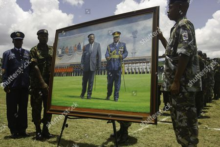 Officers of the Kenya Defence Forces Hold a Portrait of the Outgoing President Mwai Kibaki to Be Presented to Him During a Farewell Ceremony Held at Moi Air Base in Nairobi Kenya 22 March 2013 Kibaki is to Hand Over the Power Upon the Swearing-in of the New President Kenya Nairobi