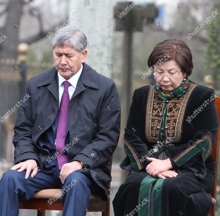 Kyrgyz President Almazbek Atambayev (l) and Former President Roza Otunbayeva (r) Pray During a Commemoration Ceremony For Victims of Violent Revolt at Ala-too Square in Bishkek Kyrgyzstan 07 April 2015 Anti-government Protests in Kyrgyzstan on 07 April 2010 Culminated in Violent Scenes in Bishkek Leaving Dozens of People Killed and Hundreds Wounded and Forcing the President Kurmanbek Bakiyev to Flee Kyrgyzstan Bishkek