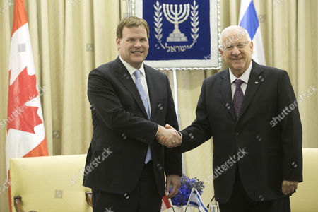Israeli President Reuven Rivlin (r) Shakes Hands with Canadian Foreign Minister John Baird (l) at the President's Residence in Jerusalem Israel 18 January 2015 Israel Jerusalem
