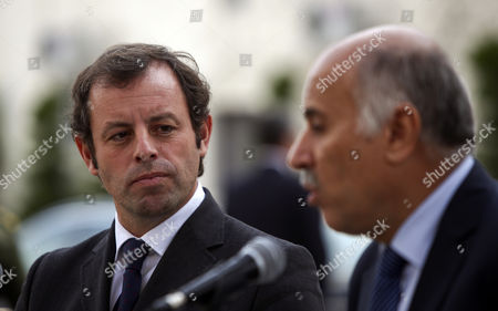 Stock Photo of Barcelona President Sandro Rosell (l) and Jebril Rajoup (r) the Head of the Palestinian Football Federation During a Press Conference After Rosell Met with Palestinian Authority President Mahmoud Abbas at Abbas' Office in Ramallah the West Bank 22 February 2013 Rosell is in the Region on a Trip to 'Strengthen Institutional and Commercial Ties' with Both Israelis and Palestinians According to Fc Barcelona's Official Website He is Also Due to Meet with Palestinian Representatives During His Two-day Trip He Announced During the Press Conference That Fc Barcelona Will Play an Exhibition Match Against an Israeli-arab Side in an Effort to Promote and Boost the Peace Process Between Israel and Palestine - Ramallah