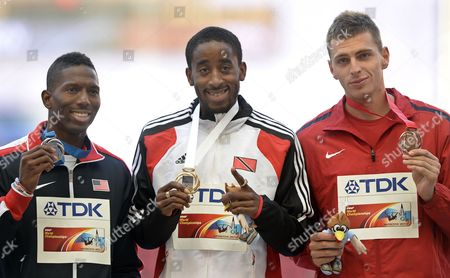 Stock Image of Gold Medalist Jehue Gordon (c) of Trinidad & Tobago is Flanked on the Podium by Silver Medal Winner Michael Tinsley (l) of the Us and Bronze Winner Emir Bekric (r) of Serbia During the Medal Ceremony For the Men's 400m Hurdles at the 14th Iaaf World Championships at Luzhniki Stadium in Moscow Russia 16 August 2013 Russian Federation Moscow